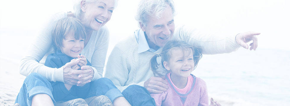 elderly-couple-smiling-with-grand-children
